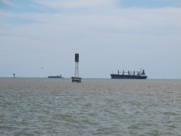 19. Katie Oxford Galveston oil spill March 2014 Tankers waiting just outside Galveston Bay. Note orange tint in water