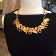 Gypsy jewelry designer Jeanette Simon with horse necklace