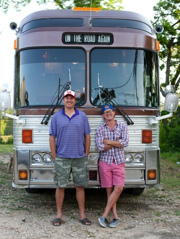 Michael Tashnick and Taylor Perkins standing in front of Willie Nelson tour bus