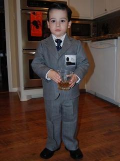 Kid dressed as Don Draper