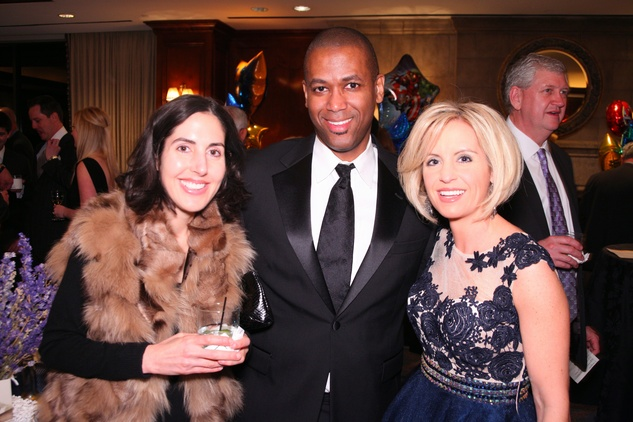 "Laura Clark, from left, Quinn Flagg and Amy Davis at Crossroads School's ""Superhero Soiree"" Gala February 2015"
