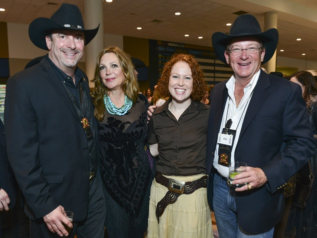 12 Sam Ray, from left, Cindi Wilson, Kristi Baker and Chip Green at the RodeoHouston Wine Auction Dinner March 2014
