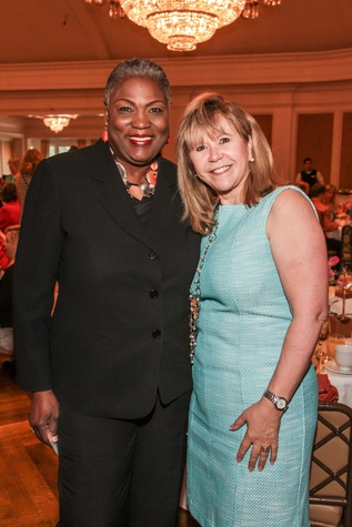 7936 Rhea Lawson, left, and Cyndy Garza Roberts at the Mayor's Literacy Breakfast May 2014