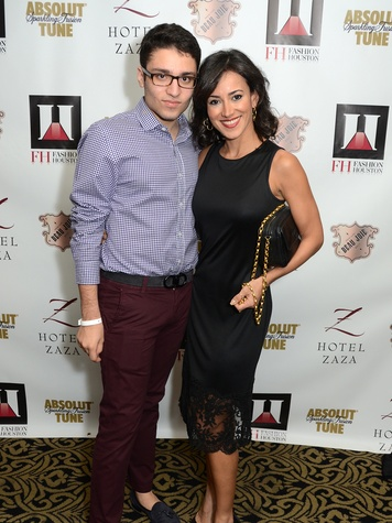 Amir Taghi and Maryam Afshari wearing Amir Taghi at the Fashion Houston Launch Party October 2013