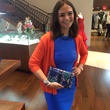 Kate Falchi with colorful clutch at Elizabeth Anthony