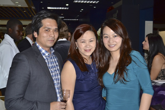 62 Wayne and Tammy Nguyen, from left, with Cynthia Xue at the Zadok Holiday Party December 2013