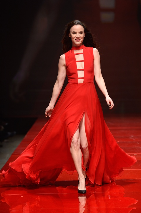 Actress Juliette Lewis walks the runway at the American Heart Association's Go Red For Women Red Dress Collection 2017