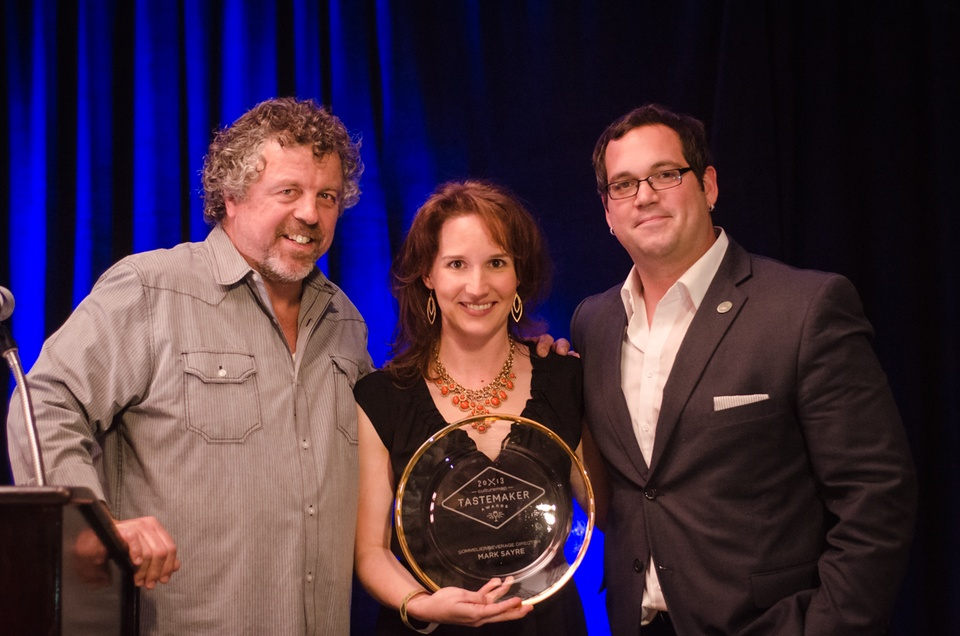 Chef Jack Allen and Jessica Dupuy pose for a photo with Mark Sayre, who won Best Sommieler