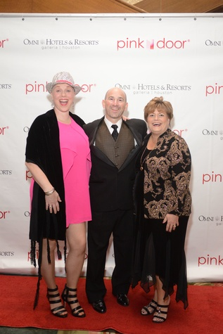 9 Alison Mitchell, from left, with Greg and Christine Hollenberg at the Pink Door Gala November 2014