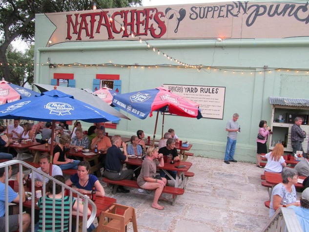 Natachee's Supper 'n  Punch patio day with people