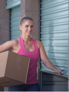 woman with box near storage unit