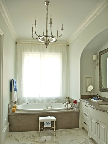 Custom bathroom with marble and chandelier