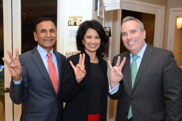 18 123 Drs. Suresh and Renu Khator, left, with Jason Fuller at the Rick Lowe Party December 2014
