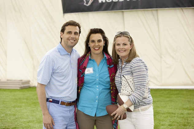 Laura and William Wheless  IV, from left, with Dawn Swanson at The Society for Leading Medicine Houston Texans Family Field Day May 2014.