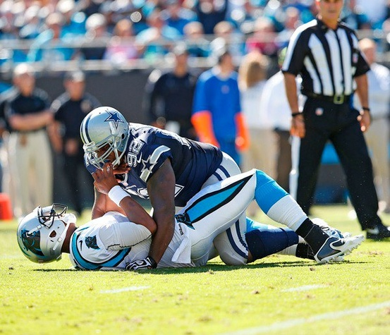 Dallas Cowboy Josh Brent sacks Carolina Panther Cam Newton