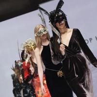 David Peck runway show models with masks at Fashion Houston