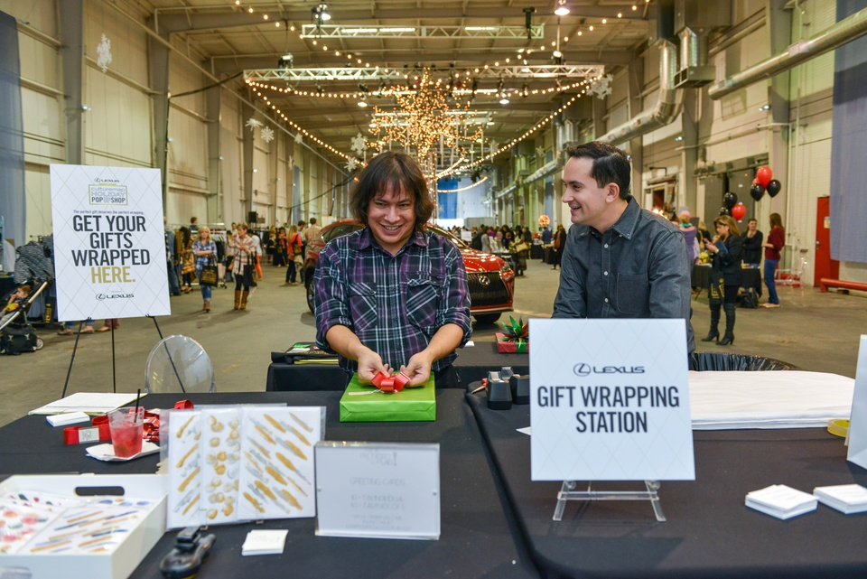 83 Lexus Gift Wrap Station at the CultureMap Pop-Up Shop December 2014 Nathan Rinard (shorter hair) and Robert Torres with The Artful Package
