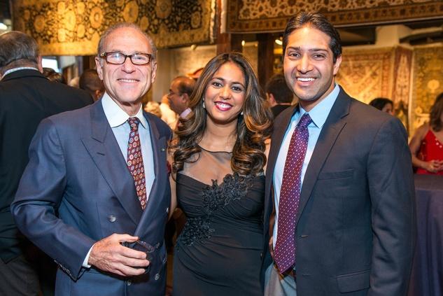 Robert Sakowitz, from left, with Rachel and Raj Duvvuri at the Abraham's Oriental Rug dinner September 2014