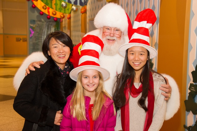 Susan Jhin and children with Santa at Children's Museum Grinch party