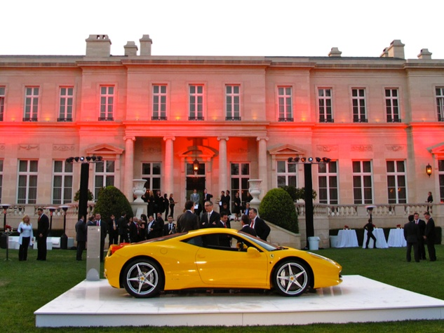 Fleur de Lys mansion with Ferrari in front Suzanne Saperstein