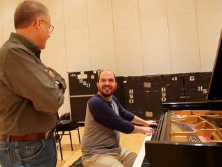 2 Kirill Gerstein prepares piano for Houston Symphony performance September 2013