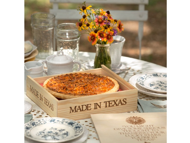 Goode Co. pecan pie in box on table with flowers 2