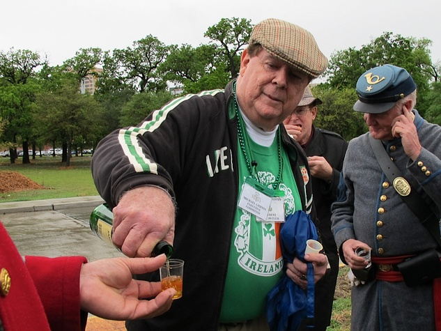 News_Katie_Dick Dowling Statute_cleaning_March 2012_Michael Griffin_President of the Irish 100 Club_serving up Irish Whiskey for a toast