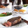 Fleming's Prime Steakhouse & Wine Bar peppercorn steak glass of wine
