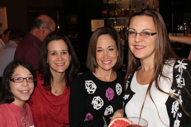 20 Montse Sarmiento, from left, Gira Rhame, Laura Davidson and Jill Buie at The Woodlands cocktail reception and gingerbread doghouse auction December 2014