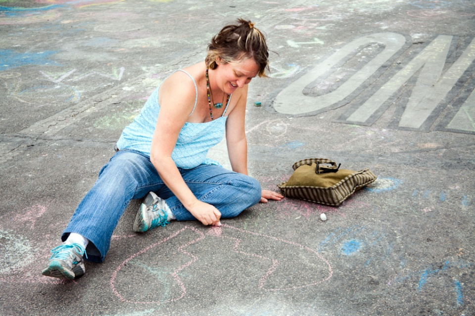 woman painting with chalk