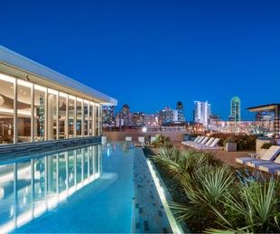 Rooftop pool at dusk at AMLI Design District