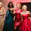 Sarah Frances Mickle, Sheri Eudaly, and Kailey Posey dance with Signature Band