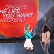 "OprahWinfreywithAmyPurdyonstageduring""Oprah'sTheLifeYouWantWeekend""attheToyotaCenter"