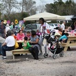 12 Guests enjoying lunch at the picnic tables at Evelyn's Park's Pop-Up event February 2014