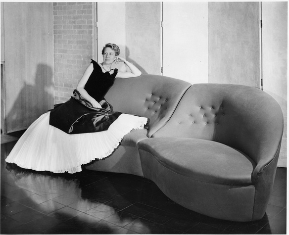 Dominique de Menil in Charles James gown on Lips sofa