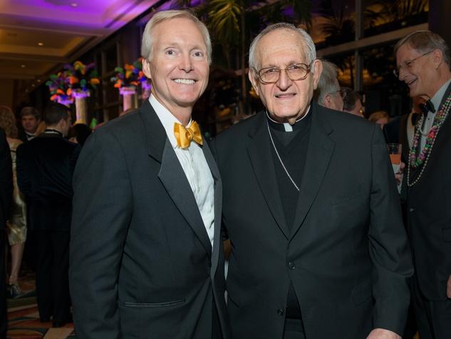 5 Doug Sandvig and Archbishop Joseph A. Fiorenza at the St. Thomas Mardi Gras Gala February 2015