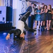 Break dancer at CultureMap fifth birthday party with Cadillac logo