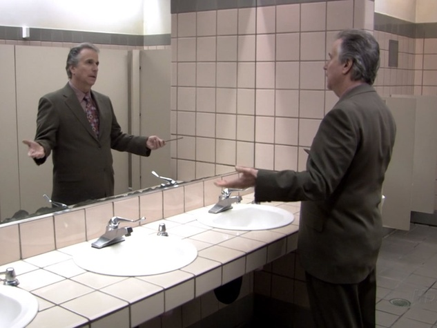 Henry Winkler doing the Fonz pose in a mirror in Arrested Development