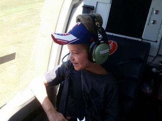 Kid rides in helicopter