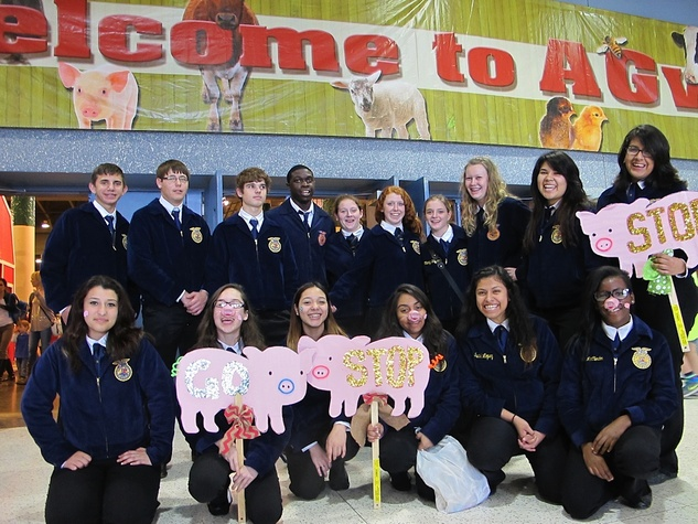 Katie Oxford Houston Rodeo FFA March 2015 Tour guides and FFA members from Needville High School, Kingwood High Schoo and Benjamin O. Davis, Jr. High School.