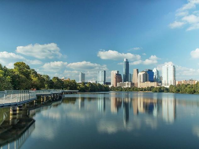 Lady Bird Lake boardwalk and Austin skyline