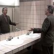 Henry Winkler doing the Fonz pose in a mirror in Arrested Development