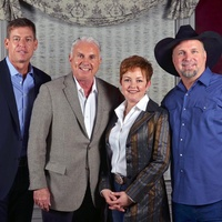 Troy Aikman, from left, Mark and Shannon Wallace and Garth Brooks at Texas Children's event November 2013