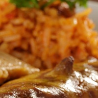 Mi Concina enchiladas, tamale and rice