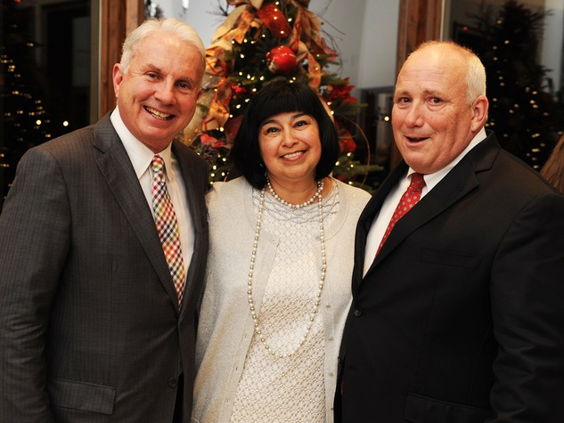 10 Mark Wallace, from left, with Amy and Dr. Charles Hankins at the Texas Children's Hospital Woodlands dinner December 2013