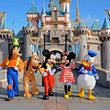 Disneyland with Goofy, Mickey Mouse, Minnie Mouse and Donald Duck