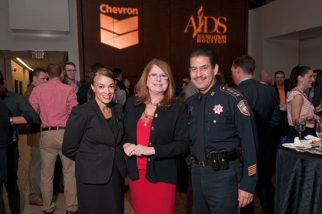 10 Karen Rawls, from left, Joni Baird and Adrian Garcia at the World AIDS Day kick-off October 2014
