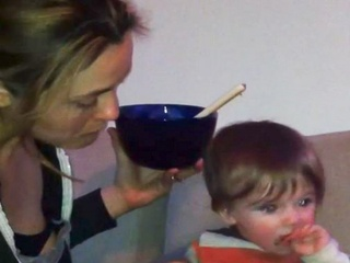 News_Alicia Silverston_Bear_feeding child by mouth