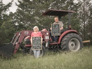 Helen and Dewan Hinsley near a tractor