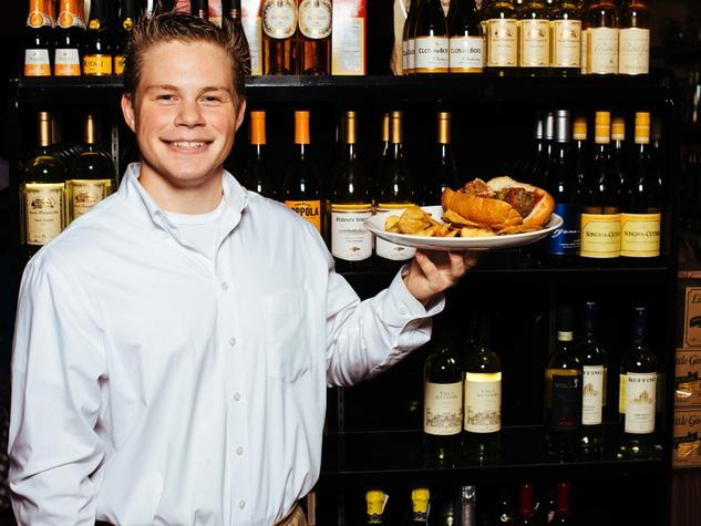 D'Amicos in Katy October 2013 A waiter holds a meatball sandwich